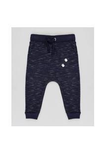 Calça Infantil Em Moletom Com Pegadas Azul Marinho