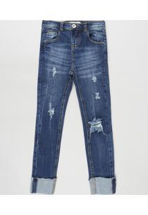 Calça Jeans Infantil Skinny Com Rasgos E Barra Dobrada Azul Escuro